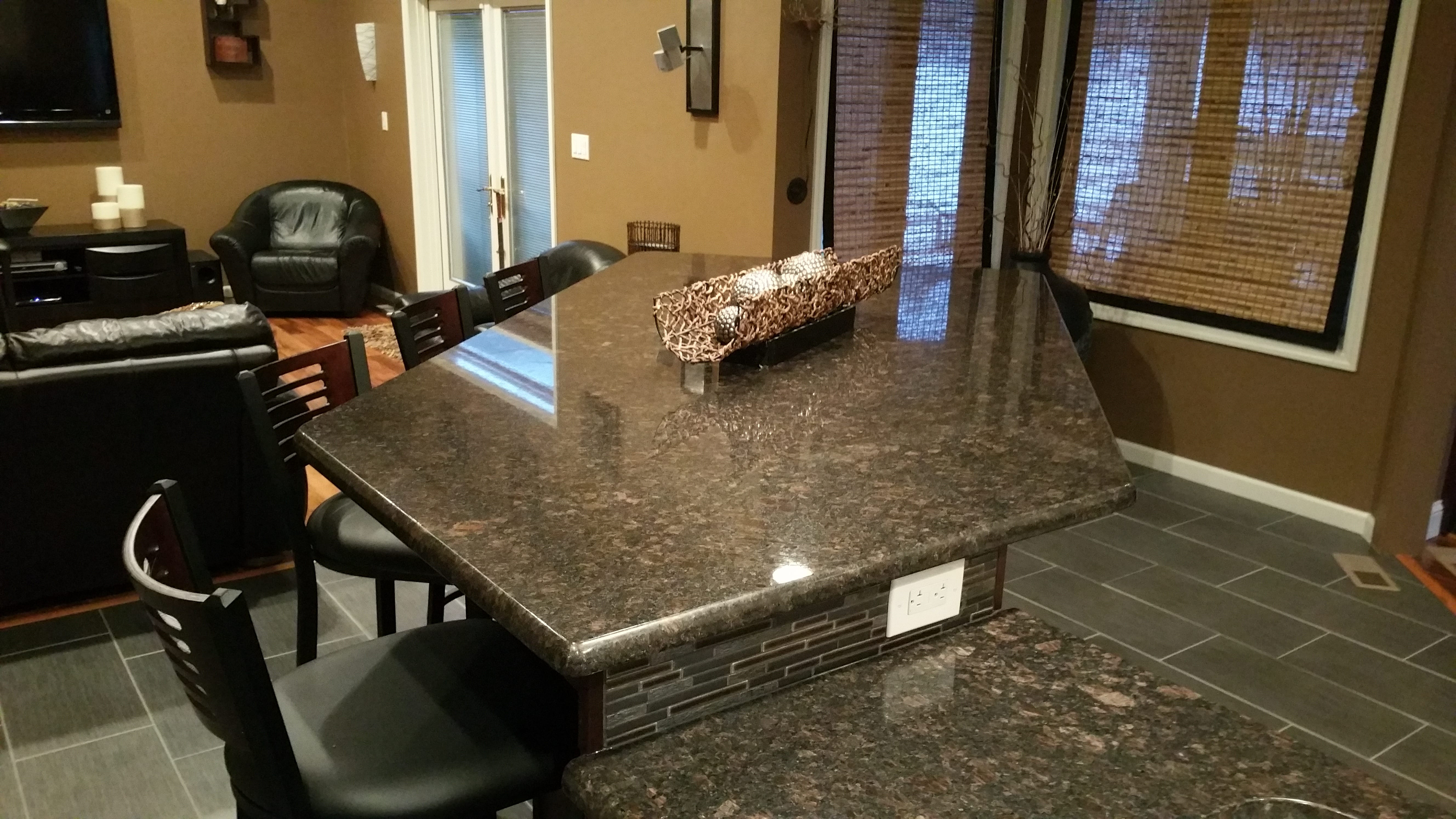 Remodeled granite island with backsplash