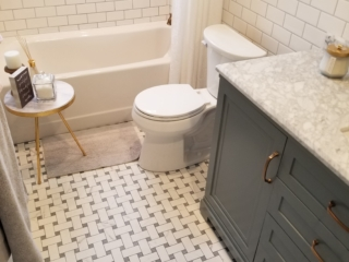 classic style remodeled main bath with basket weave Carrara floor tile