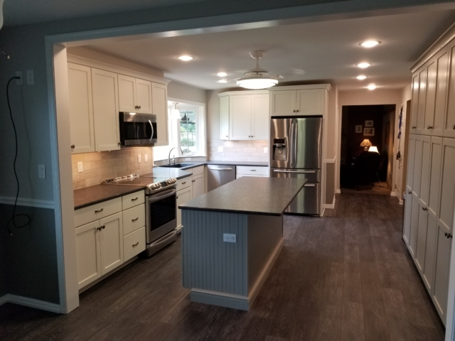 remodeled kitchen with til backsplash, bay window and new vinyl Cortex flooring