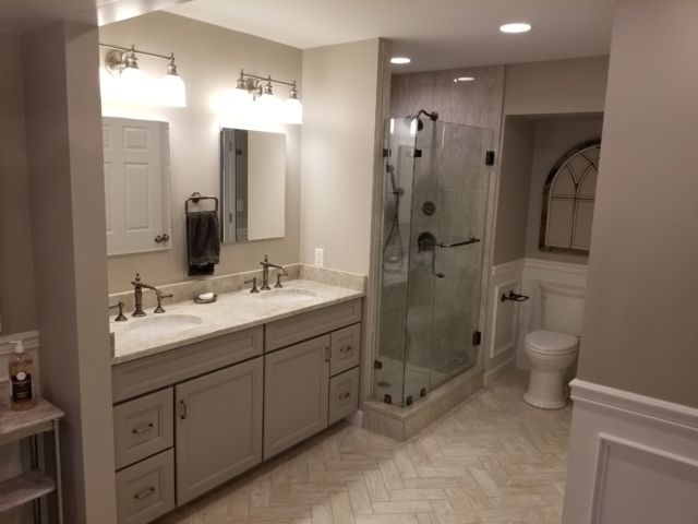 master bathroom with granite counters, tile flooring, and custom recessed lighting