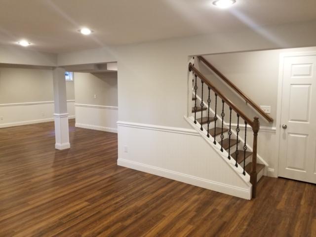 water damaged basement renovation with vinyl flooring