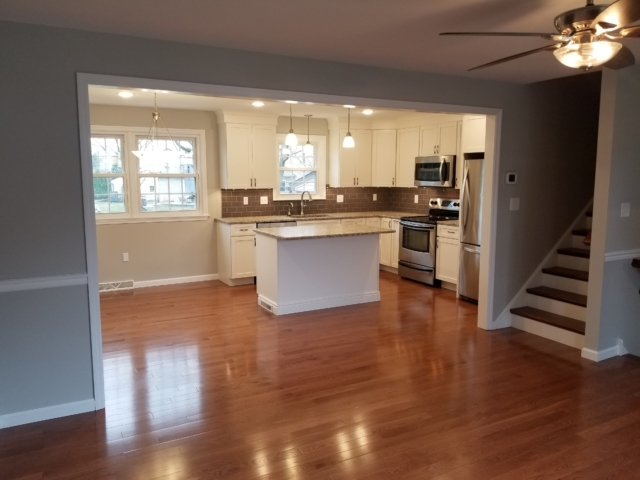 remodeled kitchen with new hardwood flooring