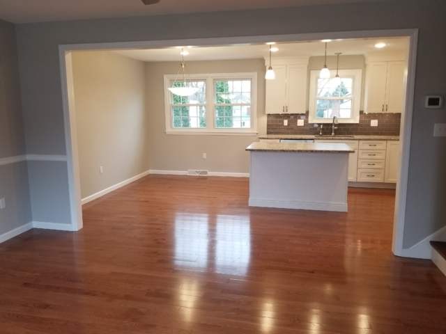 remodeled kitchen with shiny hardwood flooring