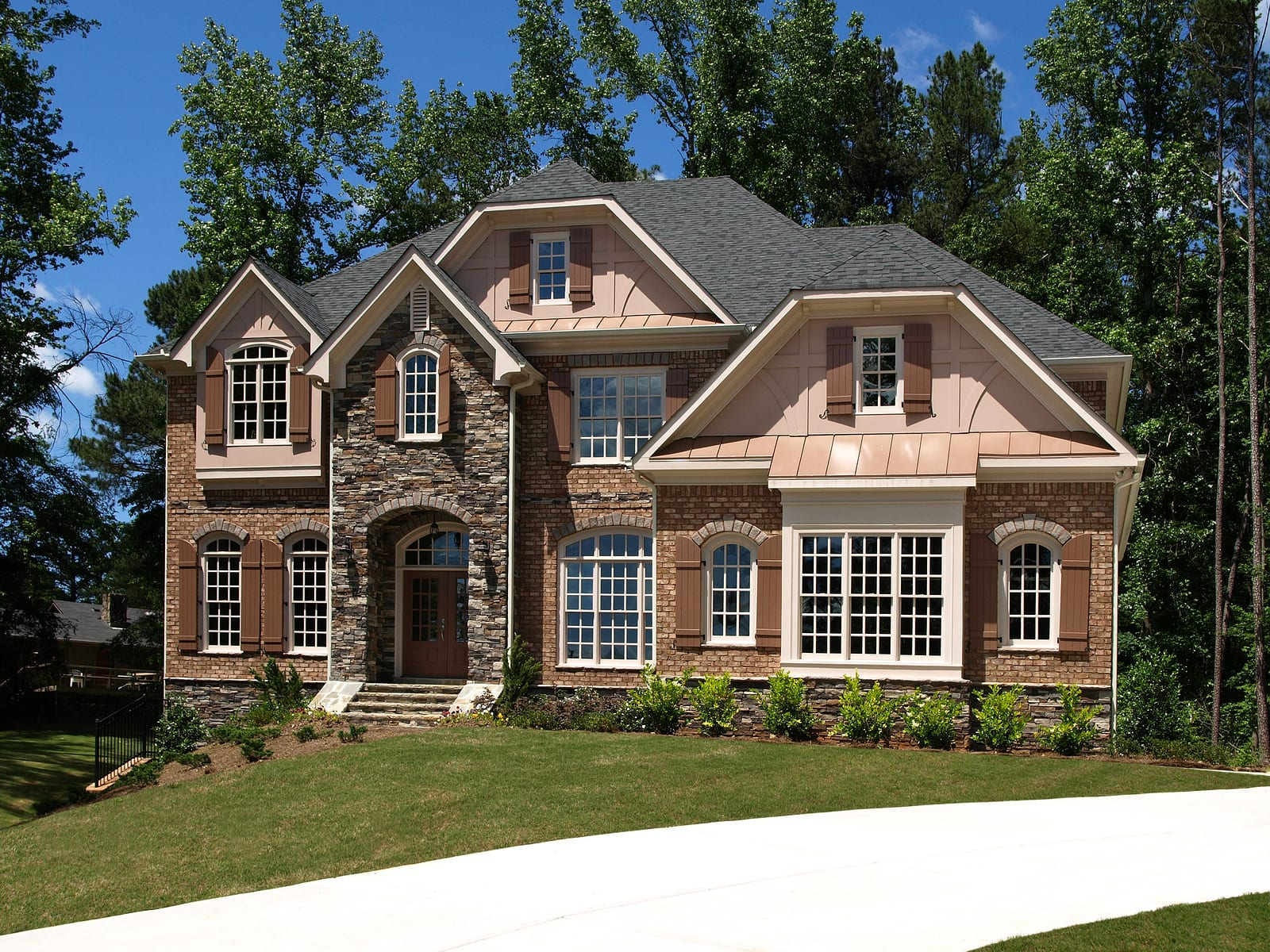 Model Luxury Home Exterior front view with driveway