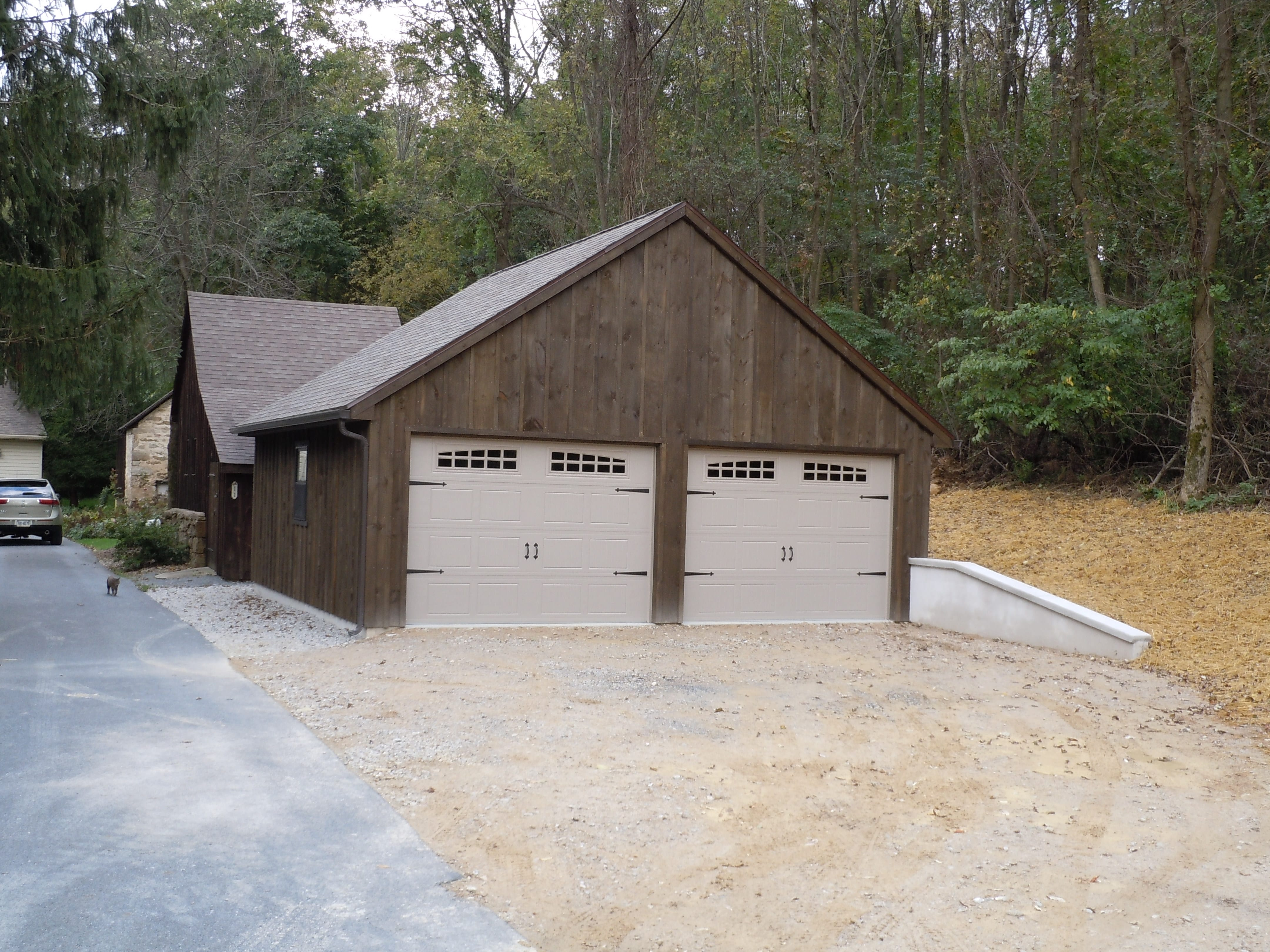 Rustic garage with white garage doors