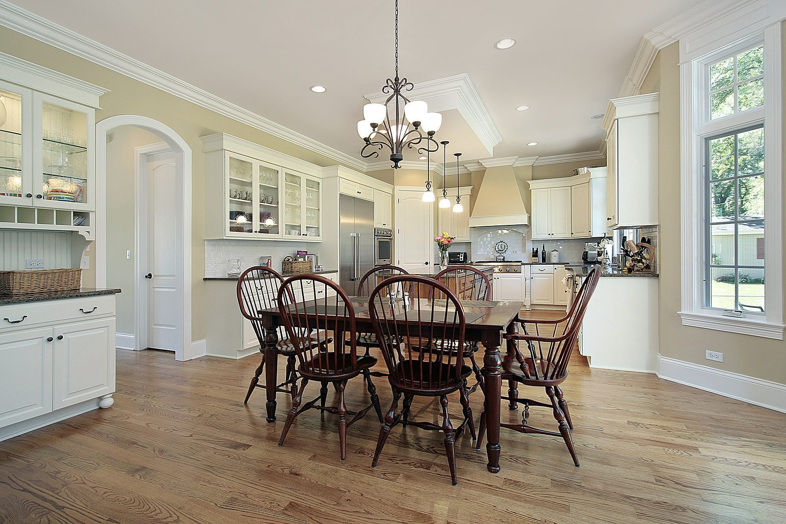 Kitchen with island and a chandelier
