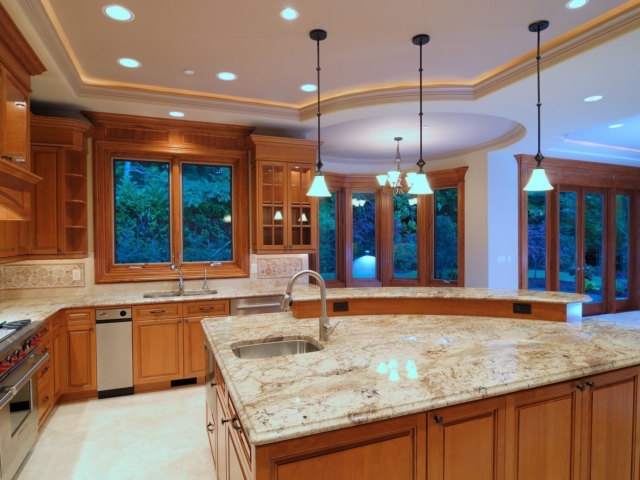 Designer large Kitchen with recessed lighting, pendant lighting and undercabinet lighting