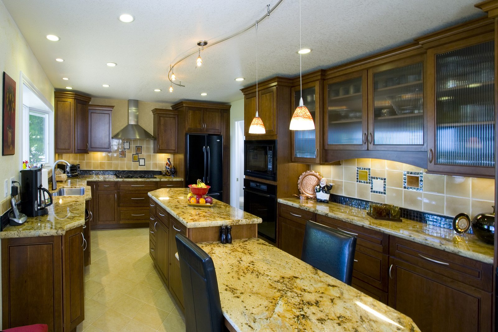 Remodeled kitchen with track lighting and rail lighting
