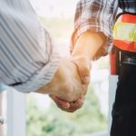 COntractor shaking hands with a homeowner after a productive discussion