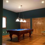 A game room remodeled from a spare room by Eagle Construction & Remodeling