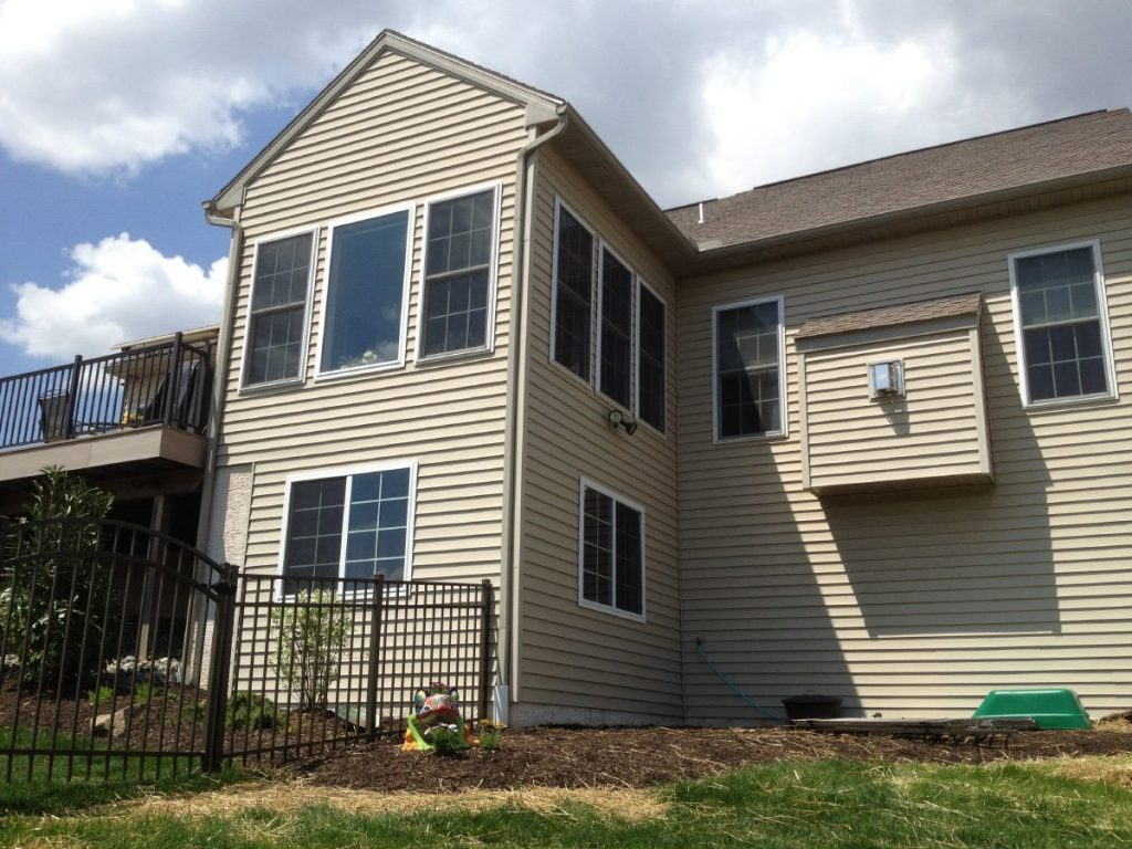 home with new vinyl siding installation
