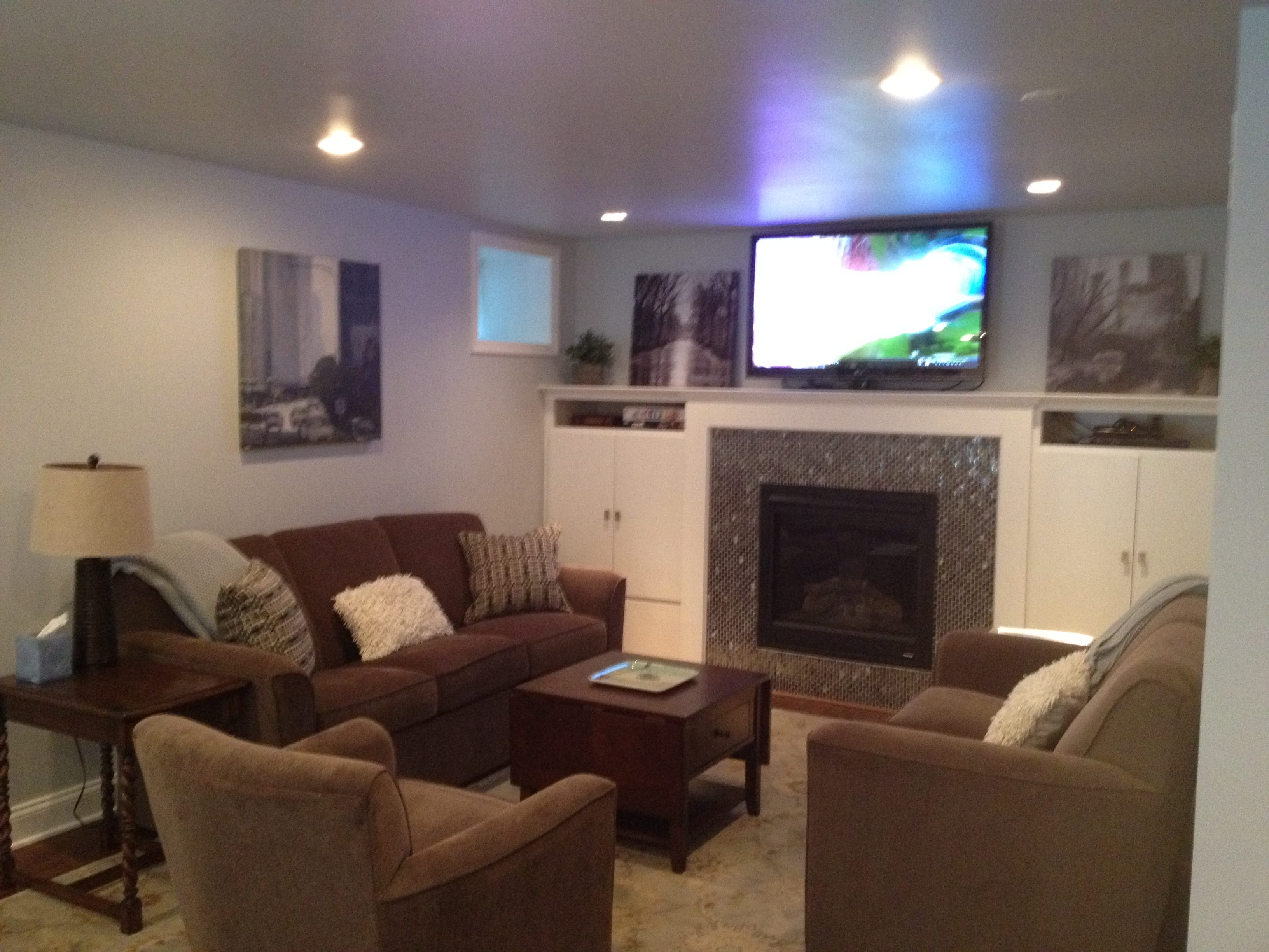 Basement with couches and television