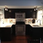 A kitchenette built by Eagle Construction in a basement remodel