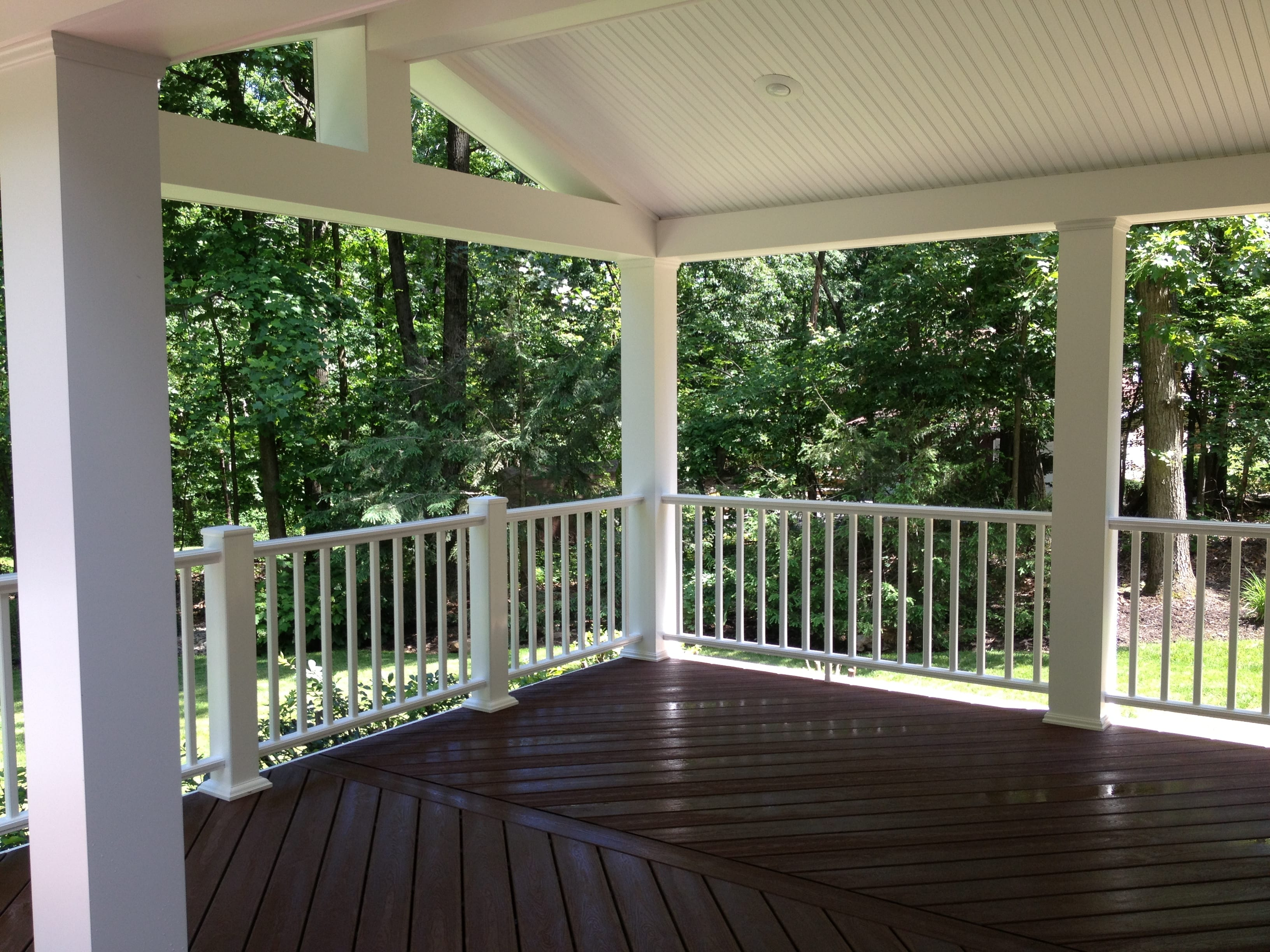 Outdoor composite deck with white roof
