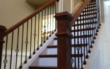 Stairs and custom wooden railing