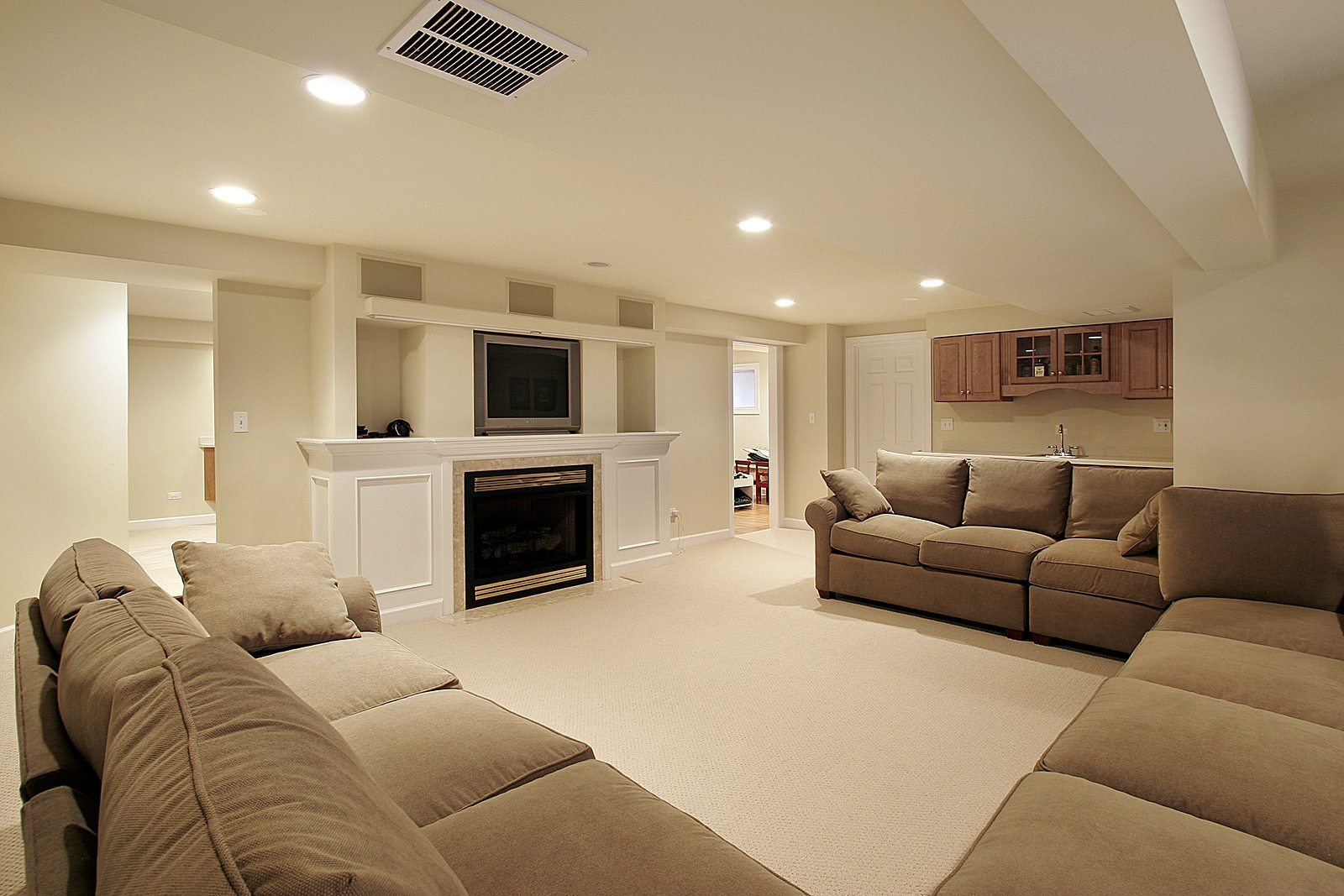 Luxury Home Basement in luxury home with white fireplace