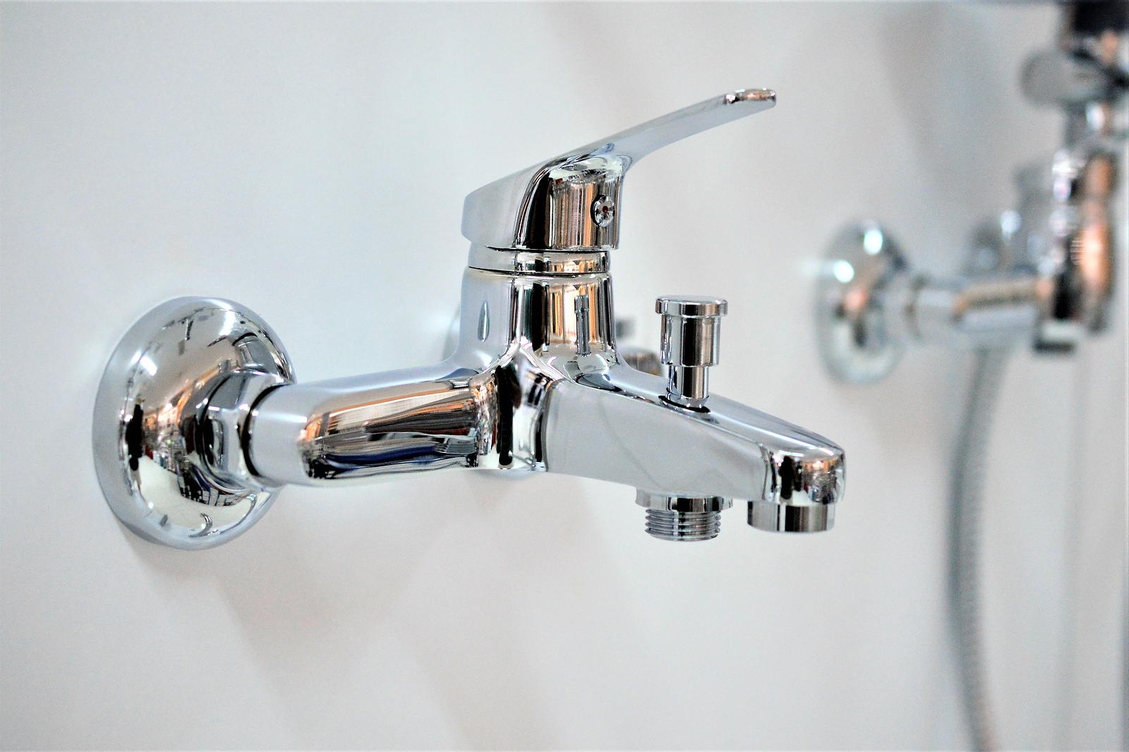 Wall-mounted single-handle faucets save counter space while offering ease of access when your hands are full