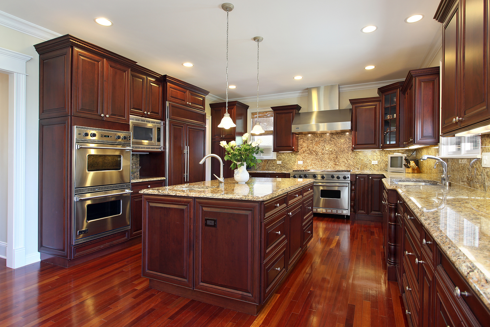 Kitchen in luxury home with cherry wood cabinetry