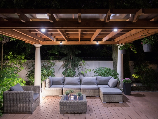 Picture of arbour with comfortable garden furniture