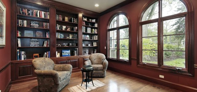 home library with wood panels