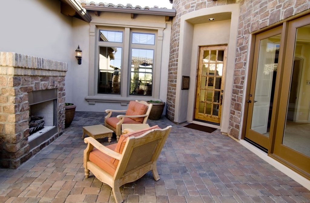 small patio with fireplace and chairs