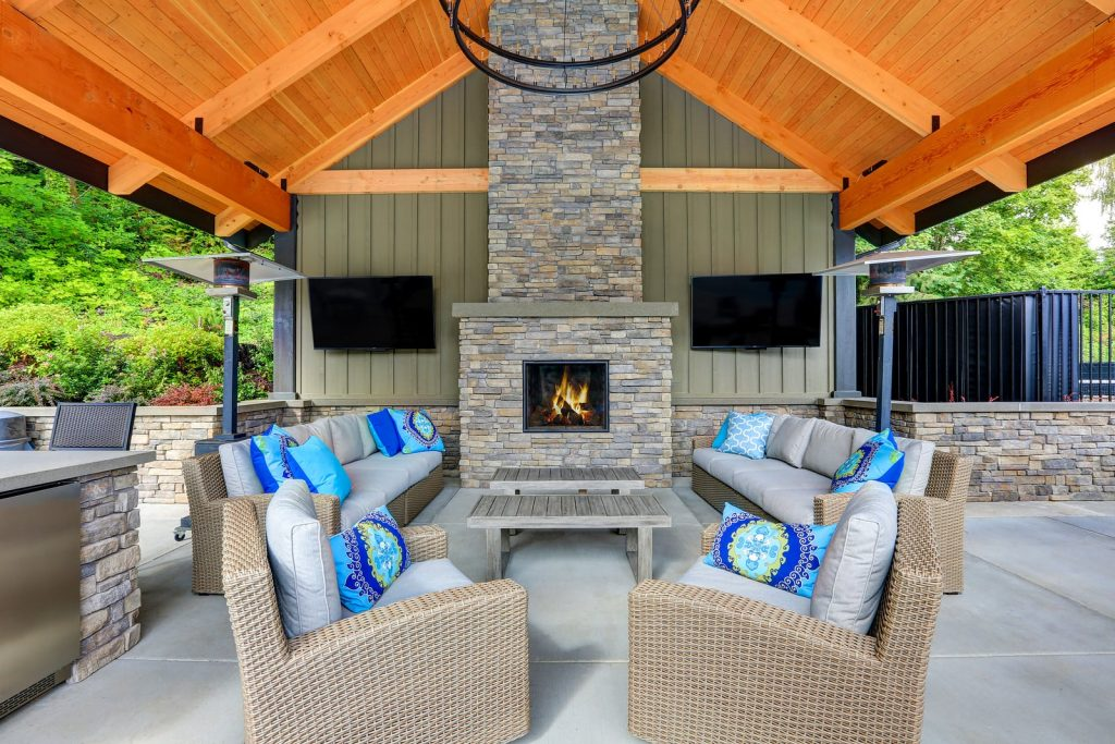 outdoor fireplace perfect for entertaining with lots of seating