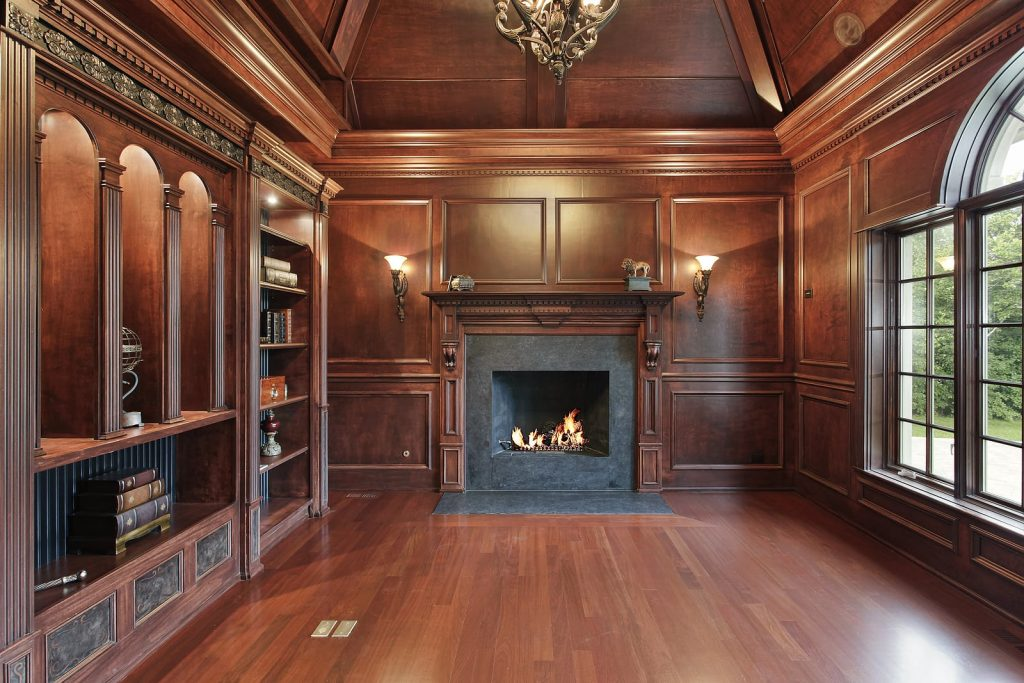library with wood paneling and hardwood floors