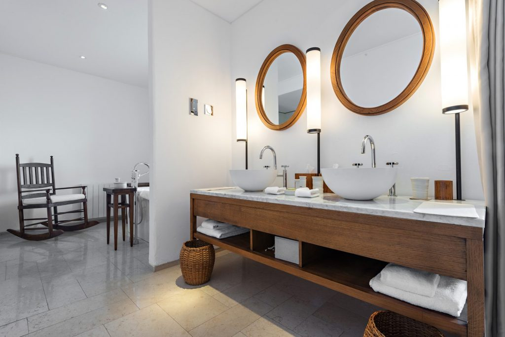 Modern bathroom interior with subtle lighting and circular mirrors